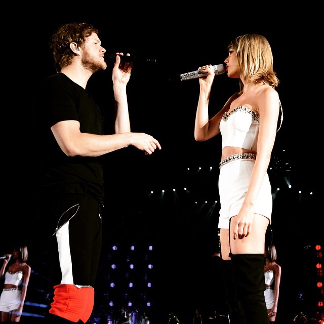Taylor Swift with Dan Reynolds of Imagine Dragons performing Radioactive